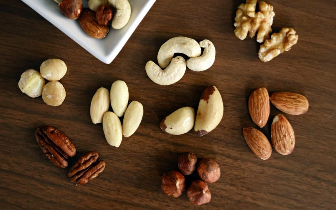 a variety of nuts on a wooden background